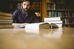 Hipster student studying in library Stock Photo