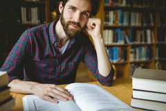 Hipster student studying in library Stock Photography