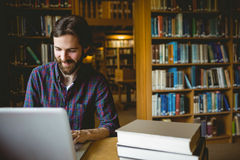 Hipster student studying in library Royalty Free Stock Photo