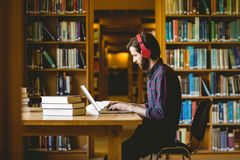 Hipster student studying in library Royalty Free Stock Image