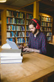 Hipster student studying in library Stock Images