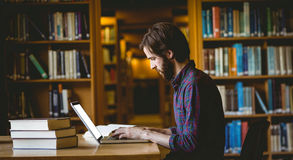 Hipster student studying in library Stock Photos
