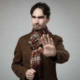 Hipster style angry man doing stop gesture Stock Photography