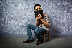 Hipster style asian man with book. stock photo