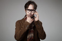 Hipster style man talking on smartphone Stock Photo