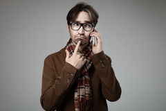 Hipster style man talking on smartphone Stock Photos