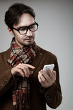 Hipster style man typing on smartphone Royalty Free Stock Image