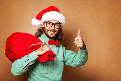 Hipster style. Santa Claus with the bag of the presents Royalty Free Stock Photos