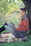 Hipster style young woman using tablet pc stock photos