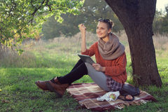 Hipster style young woman using tablet pc Royalty Free Stock Image