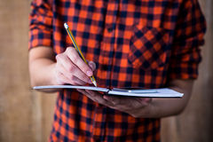 Hipster taking notes on notebooks Royalty Free Stock Images