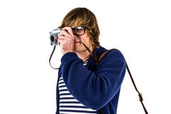 Hipster taking pictures with an old camera Stock Images