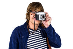 Hipster taking pictures with an old camera Royalty Free Stock Images