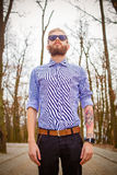 Hipster with tattoos. Simple portrait of a genuine hipster with original cool style royalty free stock photo