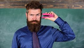 Hipster teacher formal wear with neck tie holds stapler. Back to school and studying. Teaching memorization techniques. Teacher bearded man with pink stapler stock images