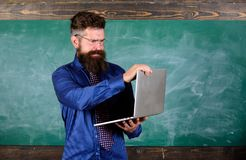 Hipster teacher wear eyeglasses and necktie holds laptop. Modern technology education. Digital technology education. Start lesson. Teacher bearded man with royalty free stock photos