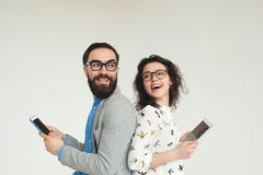 Hipster team in glasses with smartphone tablet isolated on white Royalty Free Stock Images