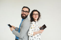 Hipster team in glasses with smartphone tablet isolated on white Royalty Free Stock Image