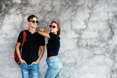 Teenage friends in same clothes royalty free stock photography