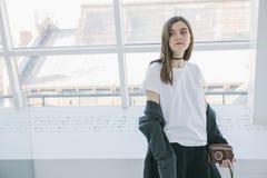 Hipster teen girl in white t-shirt light interior. Lifestile photo royalty free stock images