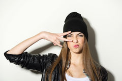 Hipster teenage girl with beanie hat posing Royalty Free Stock Images