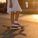 Hipster teenager with skateboard Royalty Free Stock Photo
