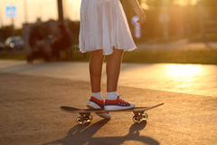 Hipster teenager with skateboard Stock Photos