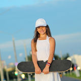 Hipster teenager with skateboard Royalty Free Stock Image