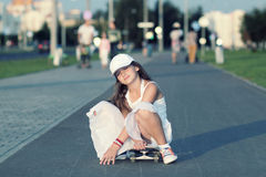Hipster teenager with skateboard Stock Photo