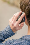 Hipster teenager talking with a smart phone Stock Photo