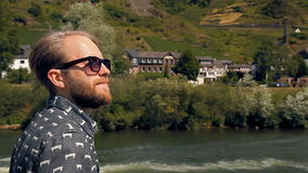 Hipster tourist is sailing on a ship stock video
