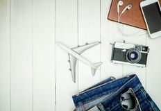 Hipster travel objects gadgets on white wooden copy space. Hipster travel objects and gadgets on white wooden copy space Royalty Free Stock Photo
