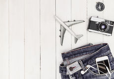 Hipster travel objects on white wood Stock Photography