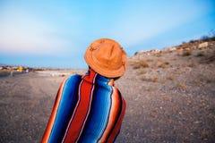 Hipster Traveler in desert, USA Royalty Free Stock Photo