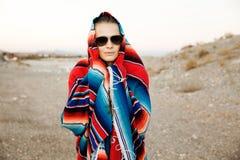 Hipster Traveler in desert, USA Royalty Free Stock Images