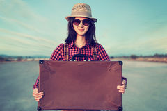 Hipster traveler with suitcase, copy-space Royalty Free Stock Images