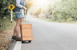 Hipster traveler woman stand with vintage luggage. On the street, concept travel and journey Stock Photos