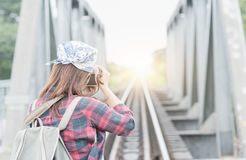 Hipster traveler woman take picture sunrise royalty free stock images