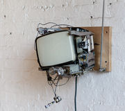 Hipster TV in Dumbo Loft. Old Television removed from case and mounted on brick wall in Hipster Loft in Dumbo Brooklyn Stock Images