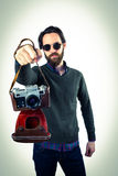 Hipster using his vintage camera Royalty Free Stock Image