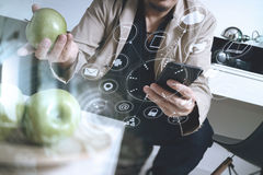 Hipster using smart phone and digital tablet computer and holdin. G credit card payments online business,sitting on sofa in living room,work at home concept Stock Photos
