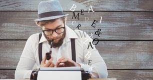 Hipster using typewriter while smoking pipe against wooden wall. Digital composite of Hipster using typewriter while smoking pipe against wooden wall Royalty Free Stock Image