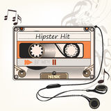 Hipster vector music background with old cassette and headphones Royalty Free Stock Images