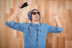 Hipster wearing sunglasses enjoying music Royalty Free Stock Photography