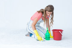 Hipster woman cleaning the ground Royalty Free Stock Images
