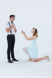 Hipster woman doing a marriage proposal to her boyfriend Stock Photography