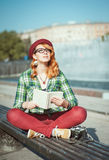 Hipster woman in hat and glasses with book Royalty Free Stock Photography