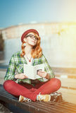 Hipster woman in hat and glasses with book Stock Image