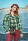 Hipster woman in hat and glasses with retro camera Stock Image