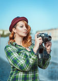 Hipster woman in hat and glasses with retro camera Stock Images